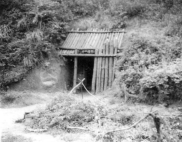 Tunnel entrance behind POW camp